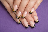 Fingernail with black french manicure
