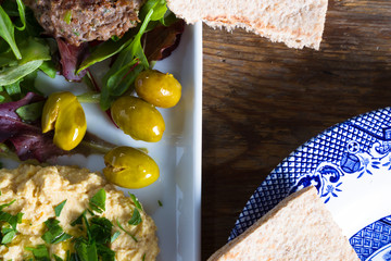 Hummous, olives and burgers