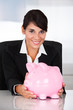 Young Happy Businesswoman Holding Pink Piggy Bank