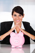 Businesswoman With Piggy Bank