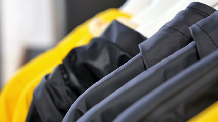 Raincoats on rack outside shop