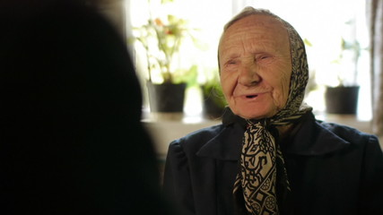 old person talking during an interview