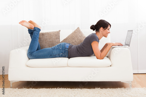 Beautiful Young Woman On A Sofa