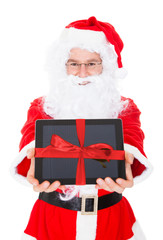 Santa holding digital tablet
