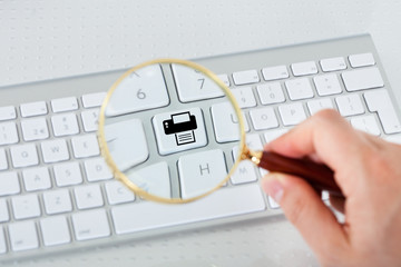 Looking at printer key through magnifying glass
