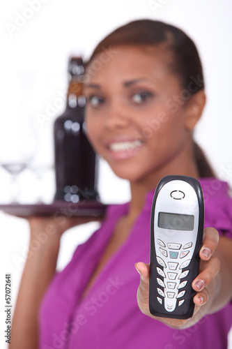 Waitress with tray and telephone