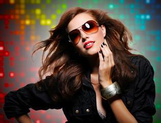 Beautiful  sexy stylish woman  in modern sunglasses