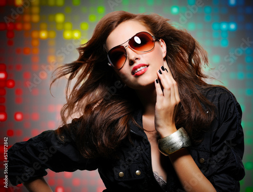Beautiful  sexy stylish woman  in modern sunglasses