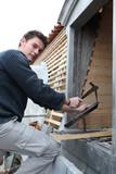 Artisan roofer at work