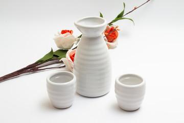 White dishes for sake with sakura