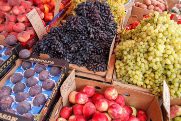 Fruit at market with price tags for sale
