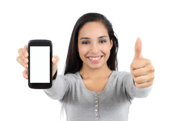 Woman showing a blank smart phone screen and thumb up isolated