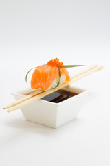 Salmon sushi nigiri with soy sauce and chopsticks