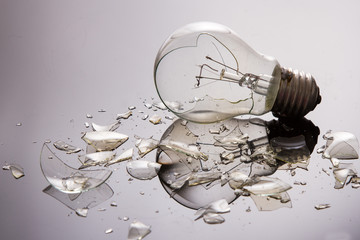 Broken light bulb on shiny surface