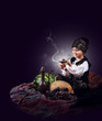 Magic scene : little boy causes of gin from old Lamp