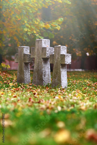 three tomb crosses