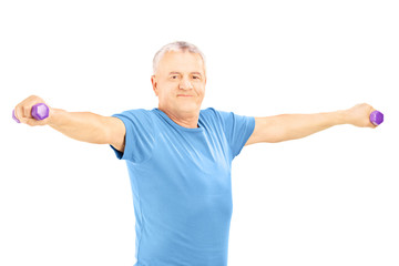 Mature man in blue shirt exercise with dumbbells