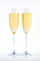 Two glasses of champagne on white