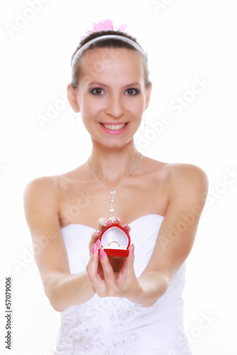 Girl with surprise looks at box with wedding ring, isolated