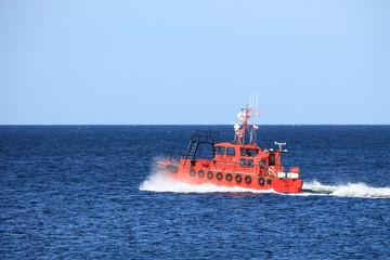 pilot boat orange tugboat at the sea
