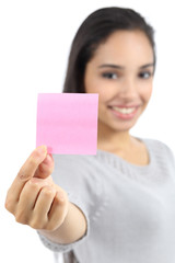 Beautiful woman showing a blank pink paper note