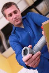 Plumber preparing plastic pipe