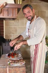 Man preparing food on barbecue