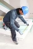 Man measuring insulation boards