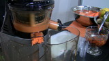 Blender making juices from vegetables