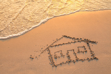 House painted on beach sand.