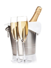 Two champagne glasses and bottle in bucket