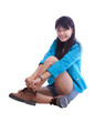 young beautiful asian woman sitting and wearing her shoes