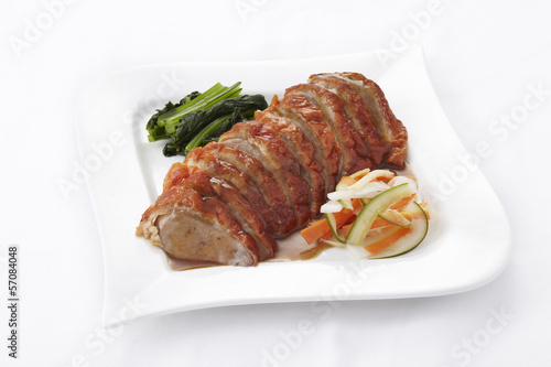Chinese style roasted duck with sauce on white background