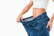 Fit woman wearing too large pants