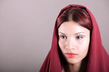young woman wrapped in scarf