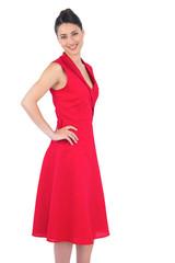 Happy elegant brunette in red dress posing
