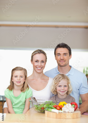 Family standing behind kitchen counter