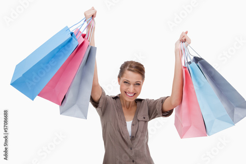Happy woman raising her shopping bags