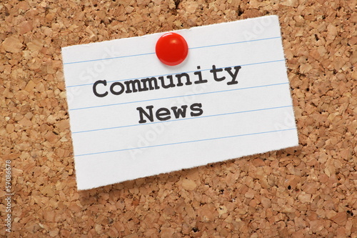 Community News paper note on a cork notice board