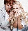 Mother soothes crying daughter