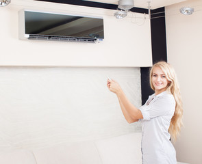 Female holding a remote control air conditioner