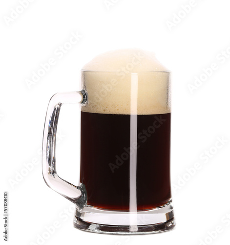 Glass with dark beer on white background