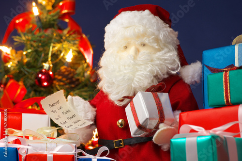 Santa Claus preparing Christmas presents. (horizontal)