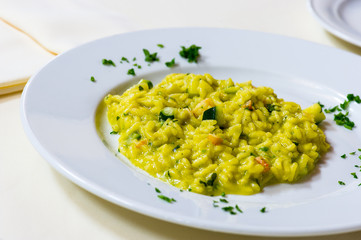 delicious risotto with saffron and  parsley leaves