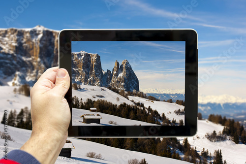 Taking picture at Siusi Alp (Italian Dolomites)