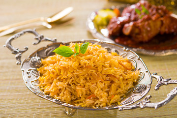 Biryani rice or briyani rice, curry chicken and salad, tradition