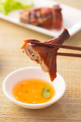 Chinese asian roast duck with chopstick and sauce