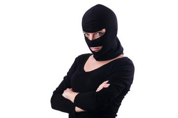 Young female burglar isolated on white