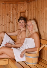 Young couple enjoying sauna