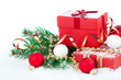 christmas red gift with festive decorations on snow background